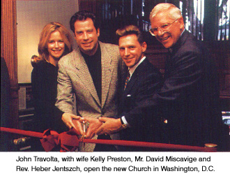 John Travolta, with wife Kelly Preston, Mr. David Miscavige and Rev. Heber Jentszch, open the new Church of Scientology in Washington D.C.